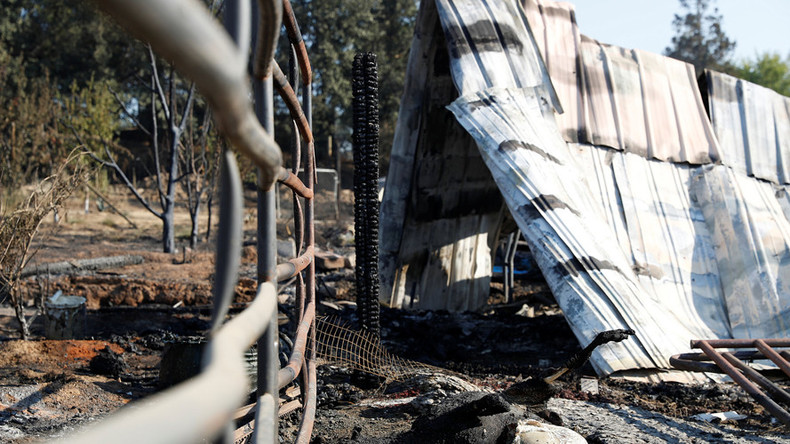 California arsonist arrested as thousands flee devastating Clayton wildfire