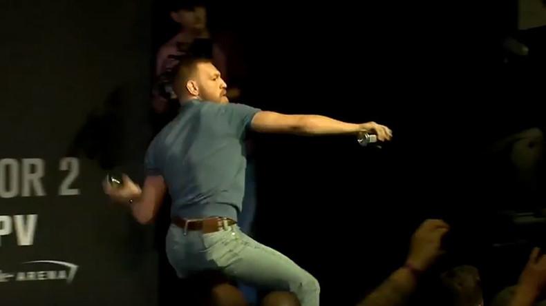 McGregor v Diaz press conference descends into bottle-throwing mayhem