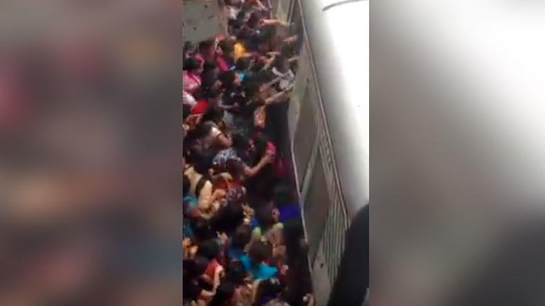 Terrifying crush at Mumbai station sees women fall under train (VIDEO)