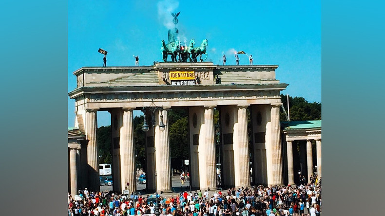 'Fortress Europe': Anti-refugee activists climb Brandenburg Gate to oppose 'rampant' immigration