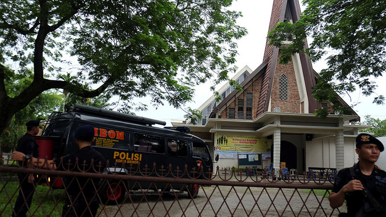 Teen attacks priest with ax, attempts to detonate bomb in crowded Indonesian church