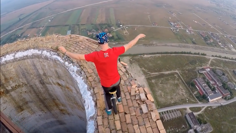 Unicyclist defies death with towering chimney balancing act (VIDEO)