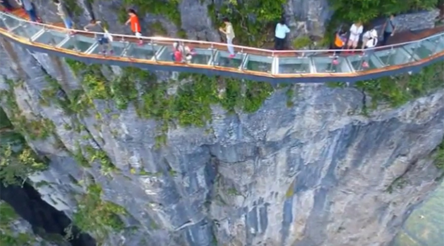 China S Terrifying Cliffside Glass Skywalk Opens With