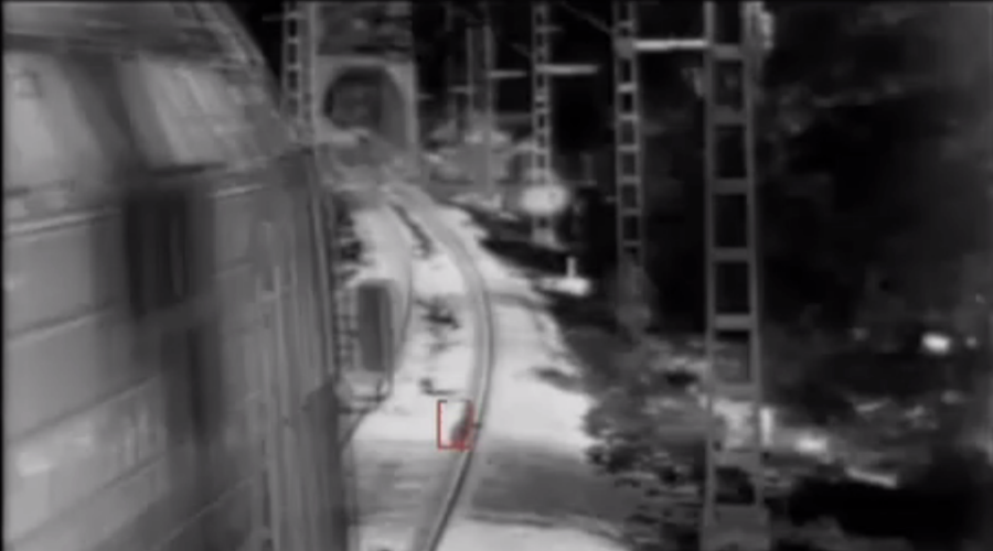CCTV catches race to save child's life as cargo train hits brakes (VIDEO)