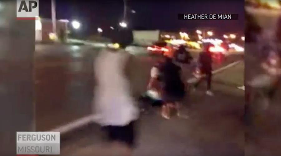 Gunshots heard after car hits Ferguson protester on anniversary of Michael Brown's death