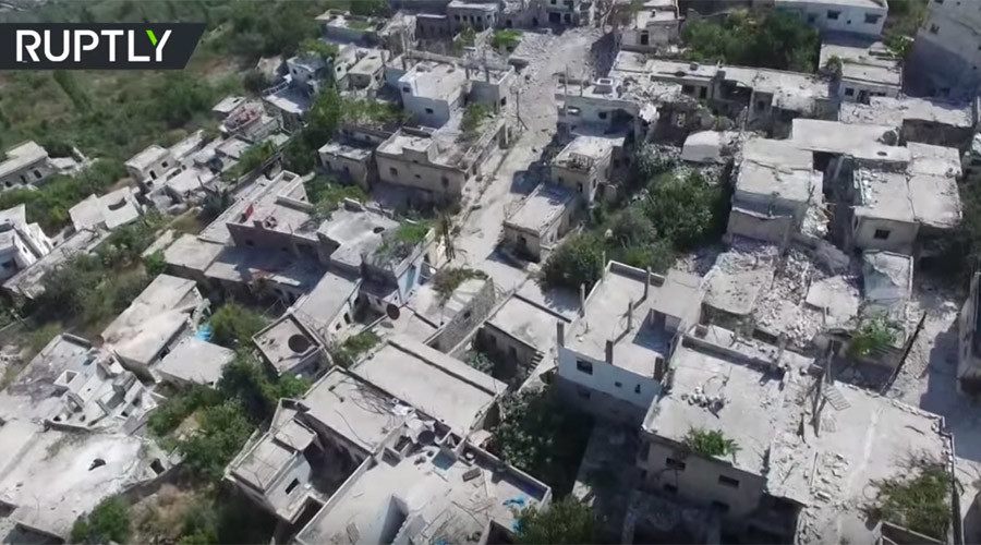 Drone VIDEO shows ruins of Kinsabba town after Syrian army liberates town