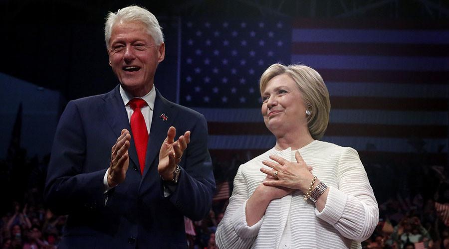 Clinton's tax returns show income hit, dubious donations