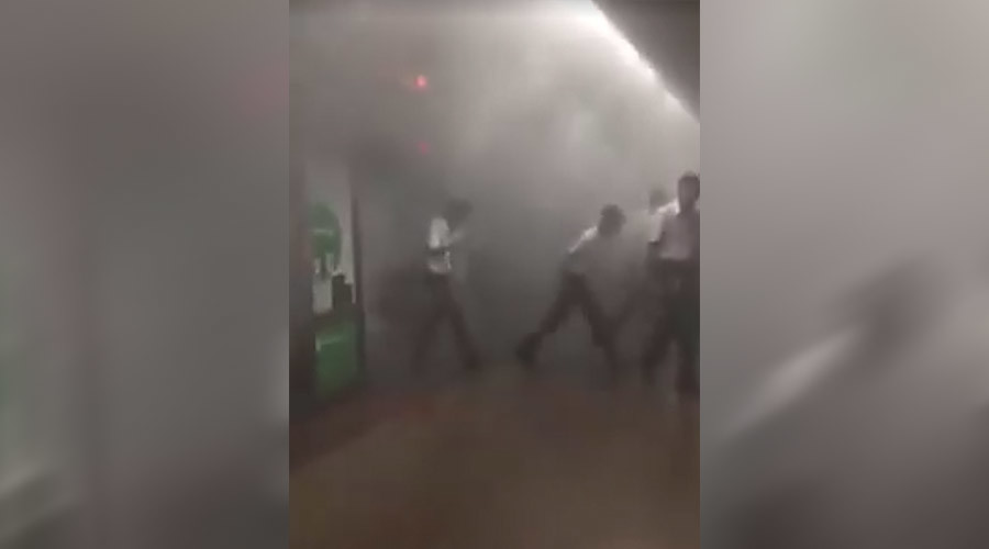 Plumes of smoke at Singapore underground train station, commuters rushing out (PHOTOS, VIDEOS)