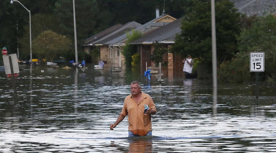 Trump visits Louisiana amid worst flooding since Superstorm Sandy