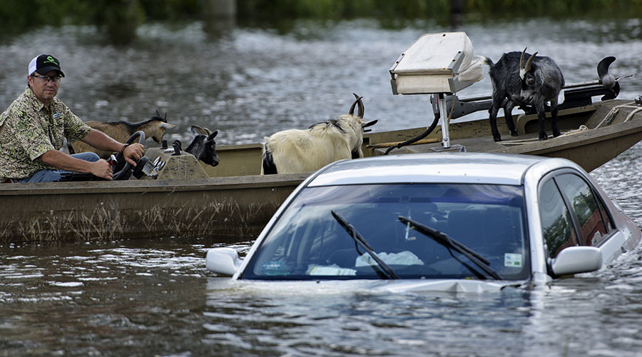 Karma in a canoe: La. pastor who says floods are God's punishment forced to flee biblical rains
