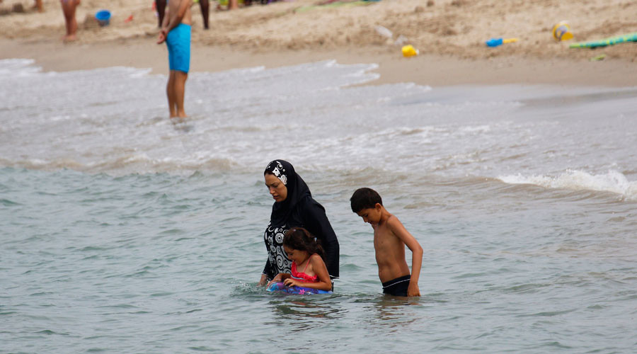 Italy rejects 'burkini' ban over terrorism fears, mulls tighter control of mosques