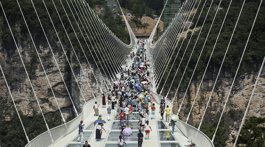 Do look down: China unveils world's longest & highest glass bridge (VIDEO)