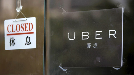 A closed sign is seen at the office of taxi-hailing service Uber Inc in Hong Kong, China © Tyrone Siu