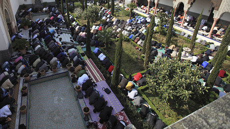 Muslims pray at a mosque in Paris. © Zohra Bensemra