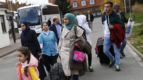 Syrian refugees arrive at the camp for refugees and migrants in Friedland, Germany. © Kai Pfaffenbach