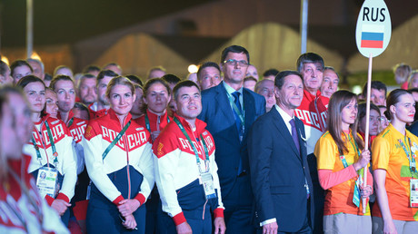 President of the Russian Olympic Committee Alexander Zhukov, fourth right, during the flag raising ceremony in the Olympic Village in Rio de Janeiro. © Grigoriy Sisoev
