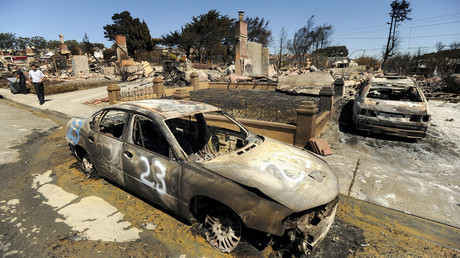 The remains of burned vehicles and homes are seen near the site of a natural gas explosion in San Bruno, California September 11, 2010. © Noah Berger