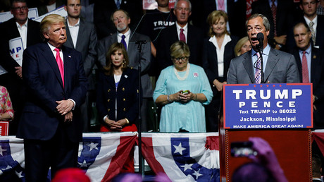 Republican presidential nominee Donald Trump (L) watches as Member of the European Parliament Nigel Farage speaks at a campaign rally in Jackson, Mississippi, U.S., August 24, 2016. © Carlo Allegri