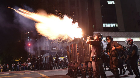 Police fire tear gas grenades at supporters of suspendend president Dilma Rousseff holding a demonstration during her impeachment trial in Sao Paulo, Brazil on August 29, 2016. © Nelson Almeida