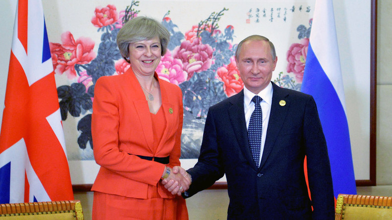 Putin & Theresa May meet for first time, hope to 'resume dialogue'