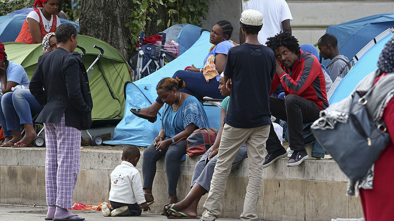 100s of migrants evicted from makeshift camp in Paris, as city plans 2 new major refugee centers