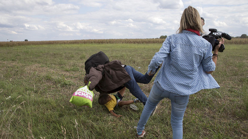 Camerawoman who kicked fleeing refugees charged in Hungary