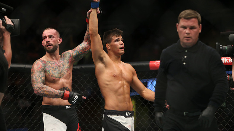 CM Punk beaten in UFC debut by Mickey Gall