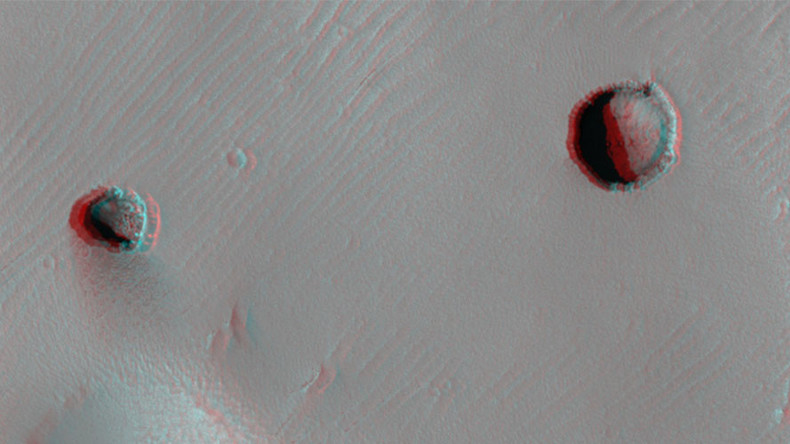 Eerily symmetrical 'pits' spotted in 3D image of Martian volcano (PICTURE)