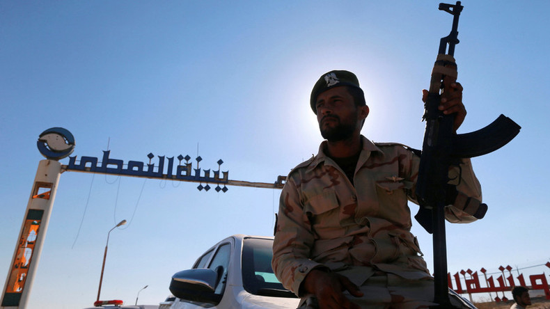 Oil edges higher on Libya unrest, output freeze possibility