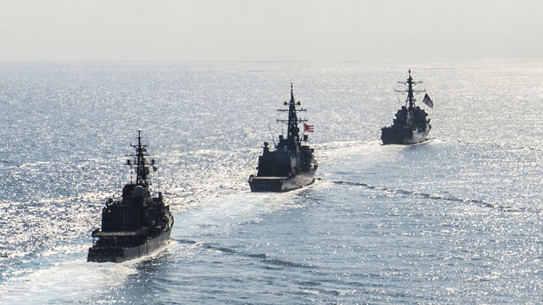 Beijing warns outsider Japan against 'playing with fire & messing in South China Sea'