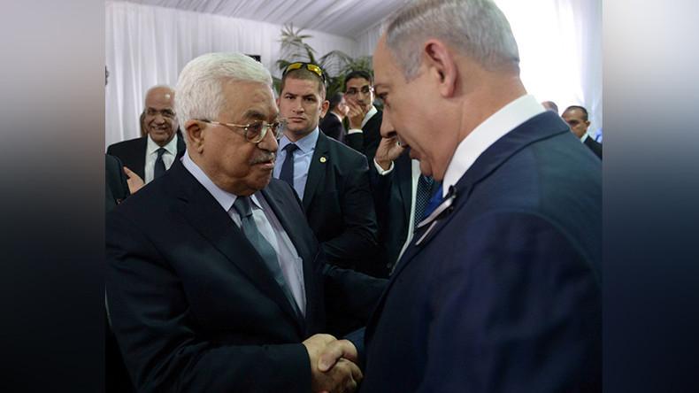 Abbas & Netanyahu exchange historic handshake at Peres funeral (VIDEO)