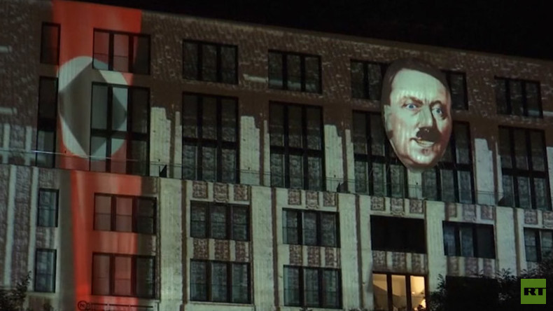 Controversial Hitler installation illuminates building in Berlin (VIDEO)