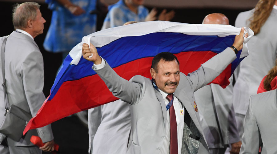 IPC revokes Paralympic accreditation of Belarus official who carried Russian flag