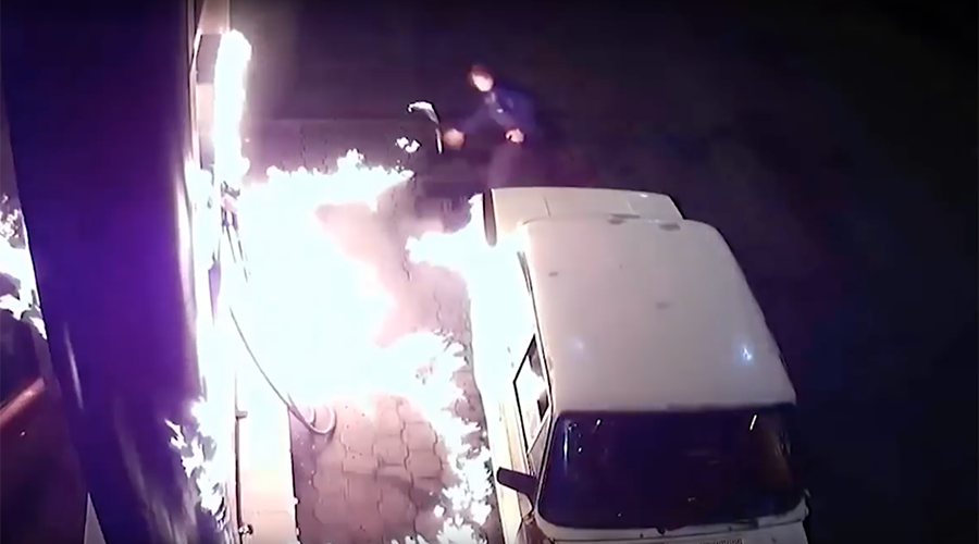 Firestarter: Russian man 'experiments' with lighter at gas station, sets car ablaze (VIDEO)