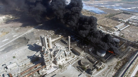 A cement plant on fire after a terrorist assault on southwest Aleppo, Syria. © Mikhail Alayeddin