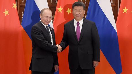 Chinese President Xi Jinping shakes hands with Russian President Vladimir Putin (L) ahead of G20 Summit in Hangzhou, Zhejiang province, China, September 4, 2016. ©Wang Zhao