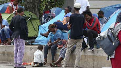 Migrants are seen at a makeshift camp on a street, northern Paris, France, September 6, 2016. ©Benoit Tessier