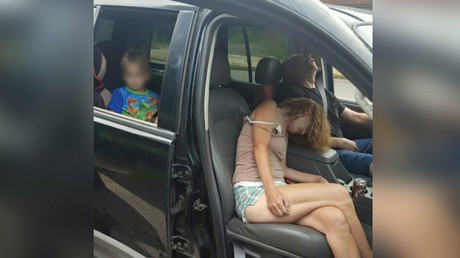 US police shame drug users with shocking photo of them passed out with child in backseat