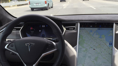 The interior of a Tesla Model S is shown in autopilot mode. © Alexandria Sage