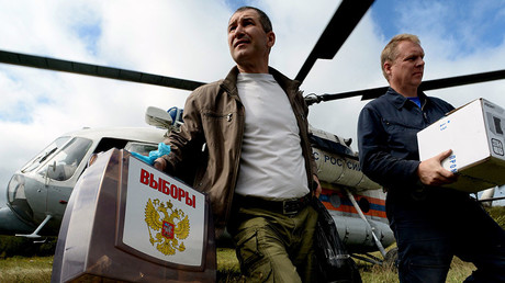 Members of a regional election commission and a helicopter crew deliver ballots, ballot boxes and equipment for voting to remote villages. © Vitaliy Ankov