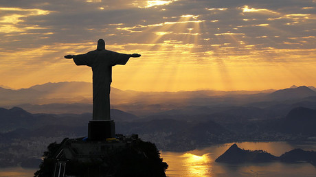 Christ The Redeemer is seen during sunrise in Rio de Janeiro, Brazil © Wolfgang Rattay