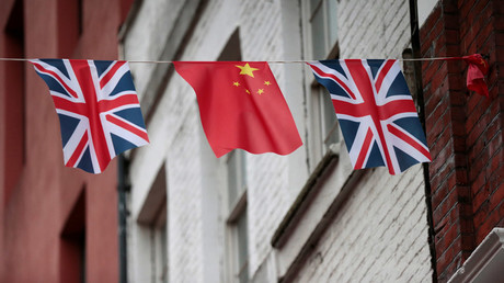 Chinese and British flags © Suzanne Plunkett