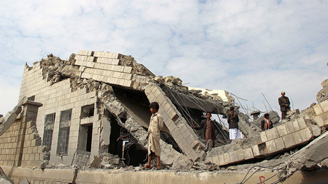 People stand on the rubble of a school destroyed by a Saudi-led air strike in an outskirt of the northwestern city of Saada, Yemen September 14, 2016. © Naif Rahma