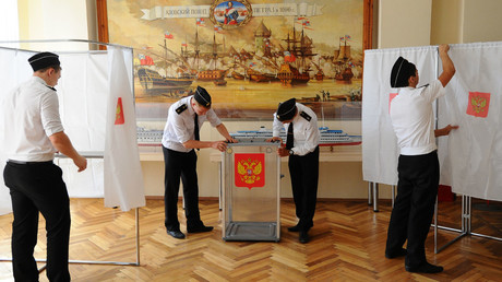 Students of the Georgy Sedov Institute of Water Transport prepare a voting station for the national election day. © Sergey Pivovarov
