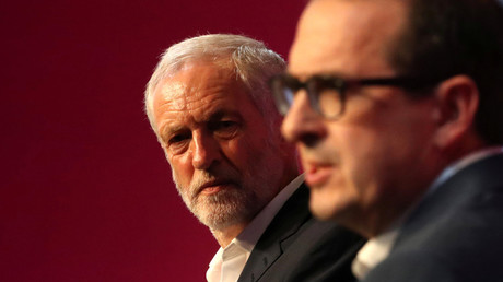 Britain's Labour leader Jeremy Corbyn (L) listens to Owen Smith during tonight's debate at a Labour Leadership Campaign event in Glasgow, Scotland, August 25, 2016. © Russell Cheyne