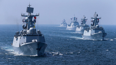 A fleet of ships sail out at sea as China and Russia's naval joint drill concludes in Zhanjiang, Guangdong Province, China, September 19, 2016. © Stringer