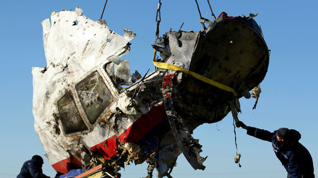 Local workers transport a piece of the Malaysia Airlines flight MH17 wreckage at the site of the plane crash near the village of Hrabove (Grabovo) in Donetsk region, eastern Ukraine November 20, 2014. © Antonio Bronic