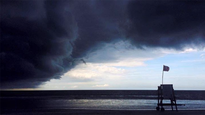 Daredevil surfers tackle Hurricane Matthew's mammoth wind & waves (VIDEOS, PHOTO)