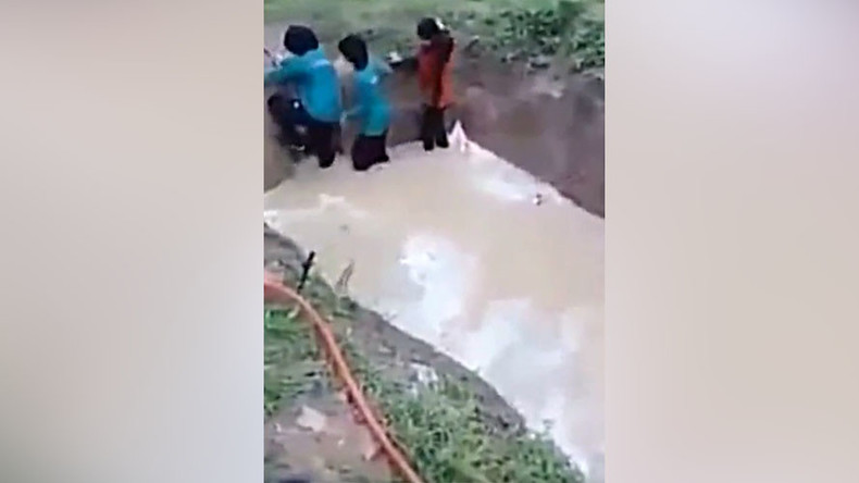 Malaysian schoolgirls forced to walk through muddy snake pit for 'team building' exercise (VIDEO)