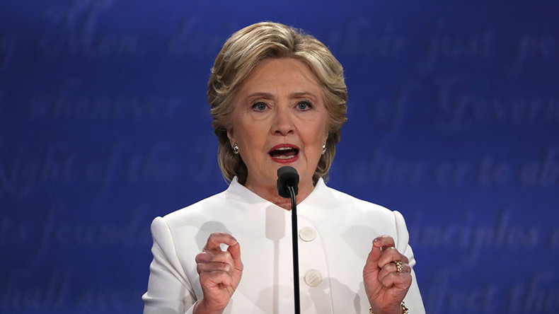 Clinton shifts debate away from WikiLeaks revelations by blaming Putin for cyberattacks